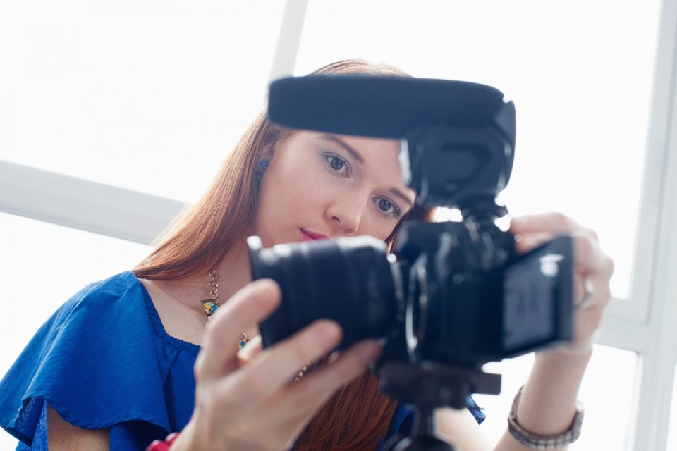 woman-recording-vlog-video-blog-using-dslr-camera-PFAS4SK